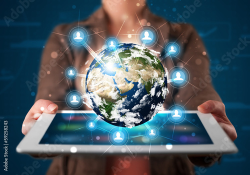 Woman presenting 3d earth globe in modern tablet