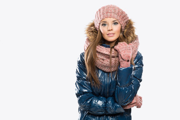 Portrait of attractive beautiful young woman wearing gloves, win