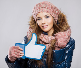 Attractive beautiful young smiling woman wearing scarf gloves an