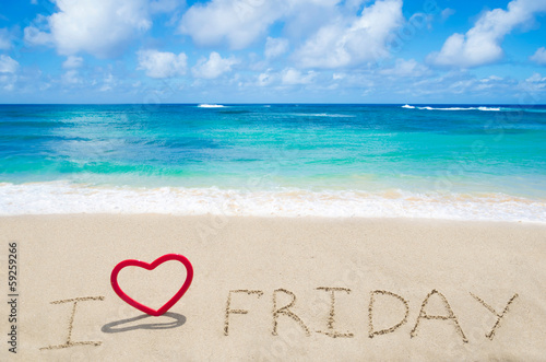 "Sign ""I love Friday"" on the sandy beach"