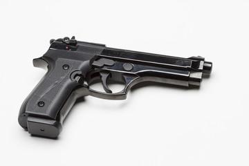 Gun against white background, horizontal