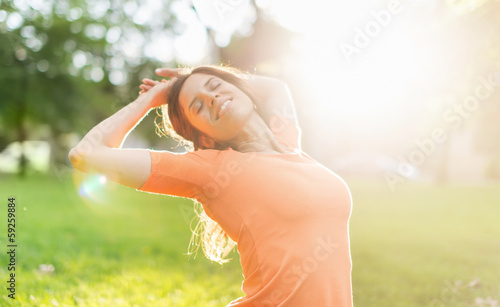 Beautiful woman enjoying the light of a summer sunset