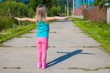 Little girl walking outdoor and having fun poster