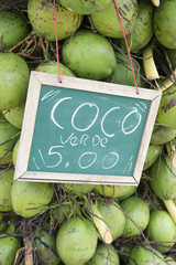 Stack of green coconuts at stall in Brazil