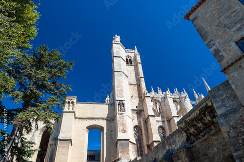 Tower and side of Saint Just Cathedral at Narbonne in France