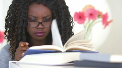 Black teen studying hard for her exam