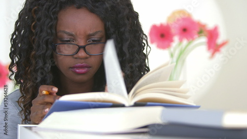 Black teen studying hard for her exam