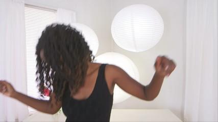 Happy black teen dancing