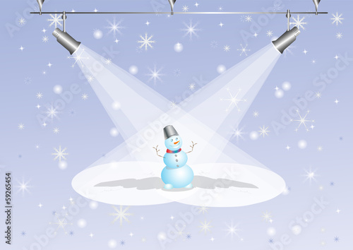 Snowman under searchlights