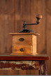 Nostalgic coffee grinder on old stool