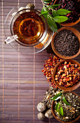 Various dry tea in small bowls