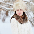 Young sensual girl in winter. Beautiful brunette posing outdoor