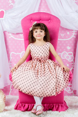 Little princess on a pink throne
