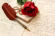 old letters, rose flower and antique feather pen