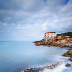 Boccale castle landmark on cliff rock and sea. Tuscany, Italy.