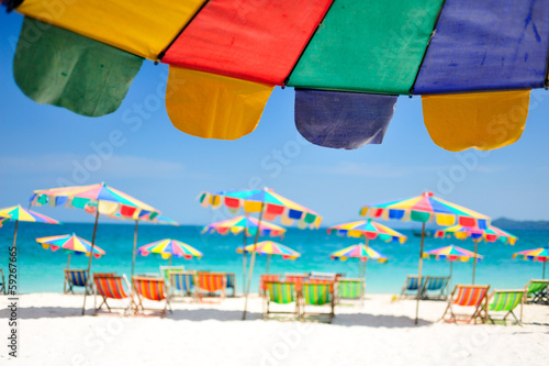 Beach chair and colorful umbrella
