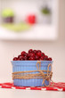 Ripe red cranberries in bowl on table