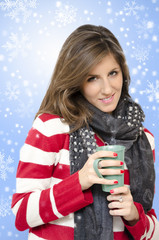 Beautiful girl drinking hot drink snowflakes backround