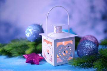 Christmas lantern, fir tree and decorations  on light