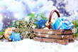 Composition with Christmas decorations in basket, fir tree
