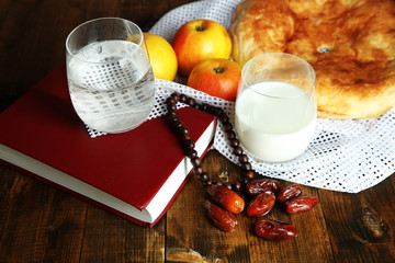 Composition with traditional Ramadan food, holy book and