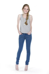 Full length of pretty young woman wearing in jeans posing