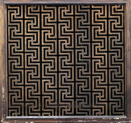 old wooden air vent with 2D meander pattern