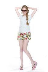 charming young female in short pants with sunglasses