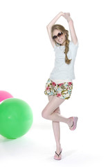 full length pretty leisure woman with slim pose with ball