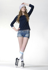 Full length young casual leisure young woman in cap posing