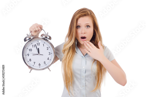 Young woman with clock on white