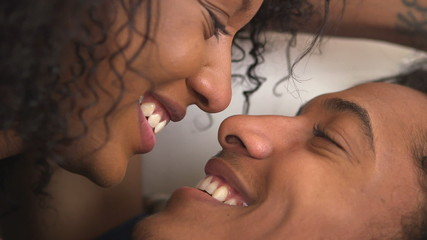 Cute black teen couple kissing and talking