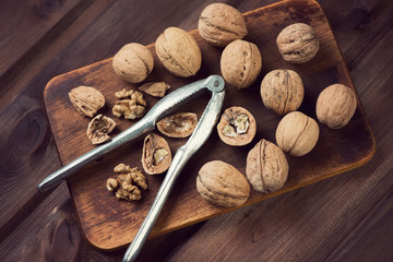 Still life with walnuts on a vintage wooden cutting board