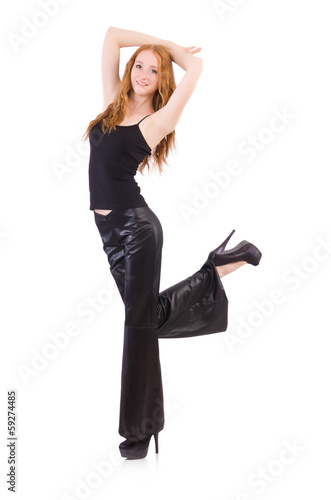 Redhead woman in black bell bottom pants on white
