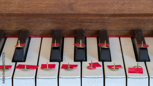 "Thumbtack on piano keys ""Silence please"""