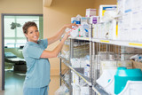 Portrait Of Nurse Working In Storage Room