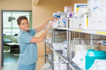 Portrait Of Nurse Working In Storage Room