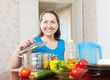 Smiling mature housewife with  vegetables