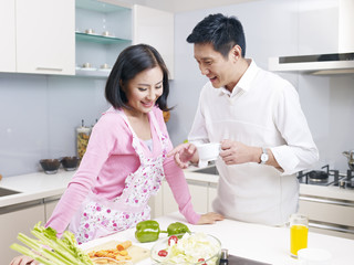 young couple talking in kitchen
