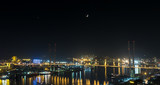Vladivostok cityscape, with Venus and the Moon on sky.