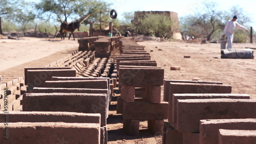 Adobe Brick Making Stacked Dolly