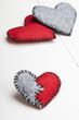 felt heart on a white wooden background, valentines composition