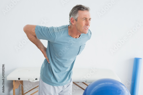 Poster Man with lower back pain at the gym hospital