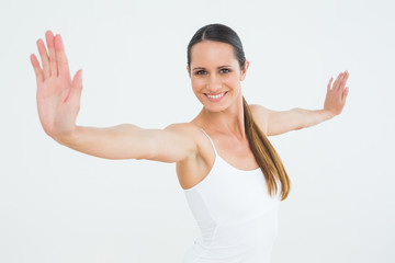Smiling fit young woman doing pilate exercises