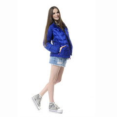 pretty model in a blue coat against white background