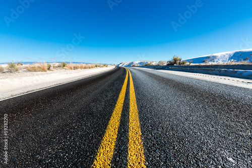 yellow dividing line on asphalt road