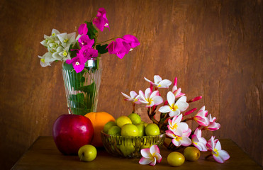 Fresh beautiful  flower and many fruit on old wood table ,still