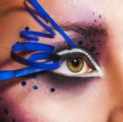 Close up photo of female eye with creative make up
