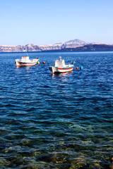A boat tied up in the clear waters of Primosten