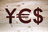 Yes article  with currency units on natural wooden background